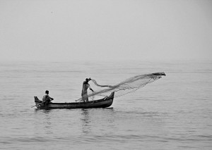 Fishing with cast-net from a boat